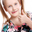 Funny girl with thumb up — Stok fotoğraf