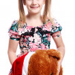 Cute girl with her teddy bear — Stock Photo