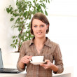 Young and happy woman with cup of coffee — Stock Photo
