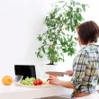 Happy woman preparing a healthy salad — Stock Photo