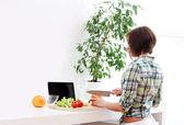 Happy woman preparing a healthy salad — Stock Photo