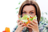 Happy woman with bowl of fresh salad — Stock Photo