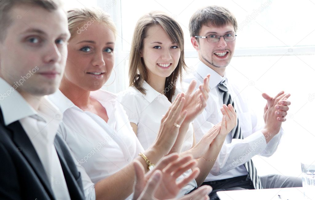 Businesspeople applauding during a business meeting — Stock Photo #10930189