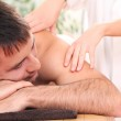 Handsome man enjoying procedure of massage — Stock Photo #11120786