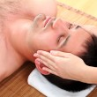 Man enjoying face massage — Stock Photo #11120797