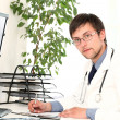 Royalty-Free Stock Photo: Young doctor working in his office