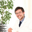 Стоковое фото: Young doctor working in his office