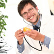 Stock Photo: Smiling doctor with orange in hands