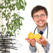 Smiling doctor with orange in hands — Foto de Stock