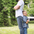 Father and his son have fun in the park — Stock Photo #11357063