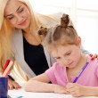 Older sister is teaching younger sister how to draw — Stock Photo #11357144