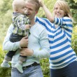 Young and happy family in the park — Stock Photo #11357404