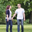 Young couple in the park — Stock Photo #11357724