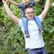 Father and his son have fun in the park — Stock Photo #11357781