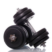 Big dumbells over white background — Stockfoto