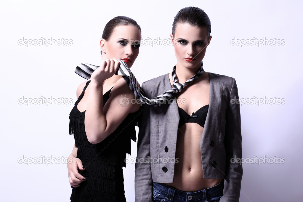 Two young and  sexy women posing in studio — Stock Photo #11357322