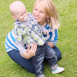 Young and happy mother with her son — Stock Photo #11465549