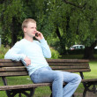 Young guy talking by cellphone - Stock Photo