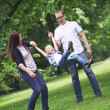 Happy young family in the park — Stock Photo