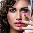 Young woman with bright make-up and manicure — Stock Photo