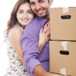 Young and happy couple are carrying boxes — Stock Photo #11834718