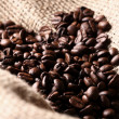 Coffee beans on cloth sack — Stock Photo
