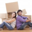 Young and happy couple are carrying boxes — Stock Photo #11834734