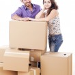 Young and happy couple are carrying boxes — Stock Photo #11834737