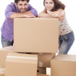 Young and happy couple are carrying boxes — Stock Photo #11834746