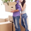 Young and happy couple are carrying boxes — Stock Photo #11834752