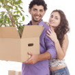 Young and happy couple are carrying boxes — Stock Photo
