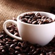 Cup full of coffee beans — Stock Photo #11834778