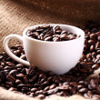 Stock Photo: Cup full of coffee beans