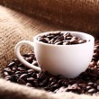 Cup full of coffee beans — Stock Photo #11834792
