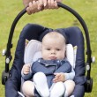Little boy in the baby seat - Stock Photo