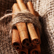 Cinnamon sticks on sack cloth - Stock Photo