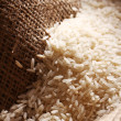 White rice grains on sack cloth — Stock Photo #11835002