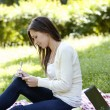 Girl studying in green park — Stock Photo