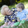 Grandmother with her grandson in the park — Stock Photo