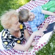 Grandmother reading book to her grandson — Stock Photo #11835136
