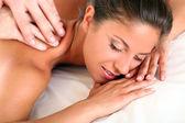 Woman enjoying a massage therapy — Stock Photo