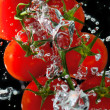 Stock Photo: Tomatoes in the water with air bubbles