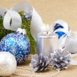 Blue and white christmas balls with silver candle — Stock Photo