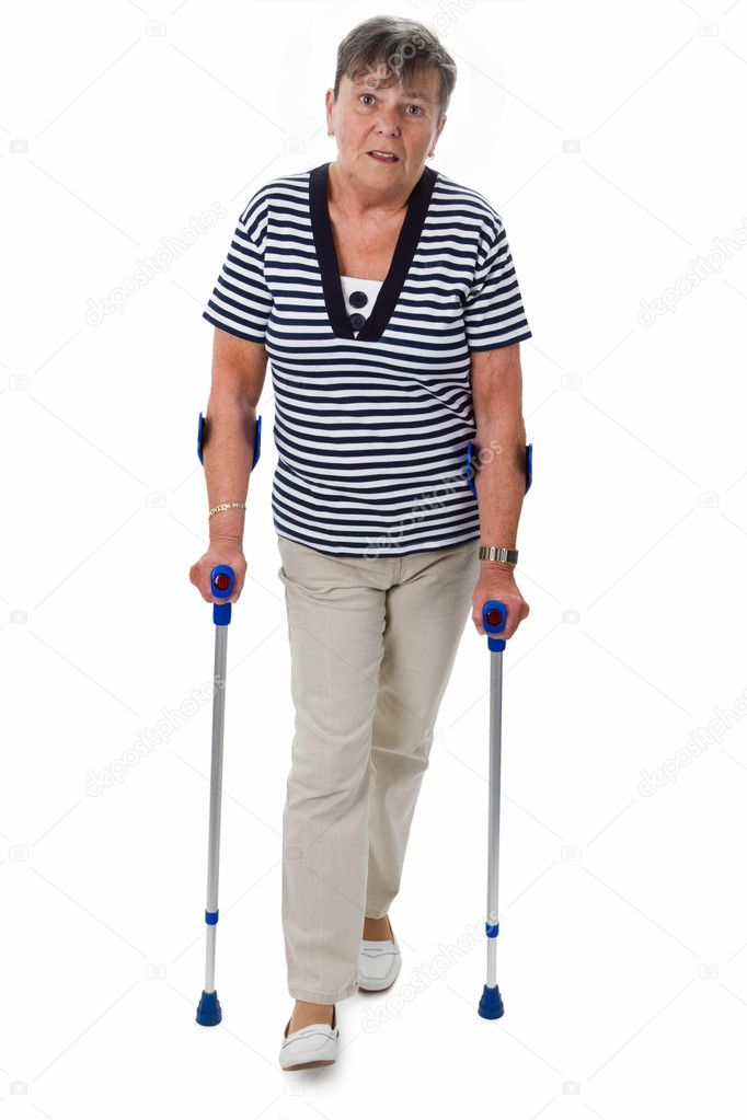 Senior woman with crutches - isolated on white — Stock Photo #11465608