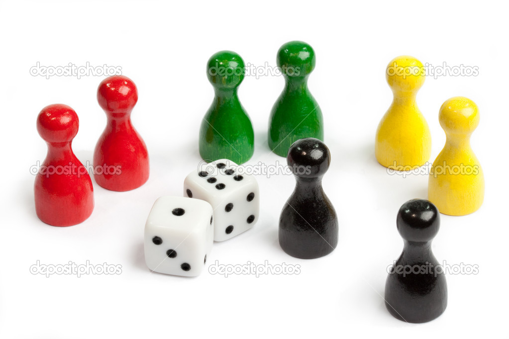 Four pairs of meeples in different colours standing around dices  Stock Photo #12188049