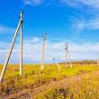 Old powerline at the field — Stock Photo