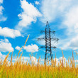 High voltage lines and cloudy sky — Stock Photo
