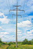 Powerlines and cloudy sky — Stock Photo