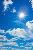 White clouds with sun in the blue sky — Stock Photo