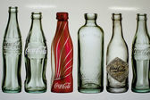 Empty bottles of coca cola — Stock Photo